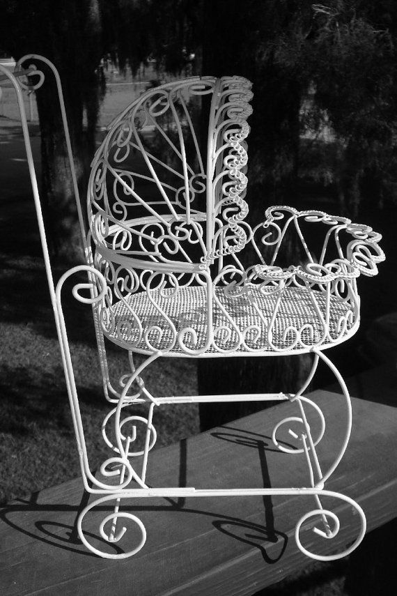 Antique wire carriage perfect for baby shower for Baby carriage decoration