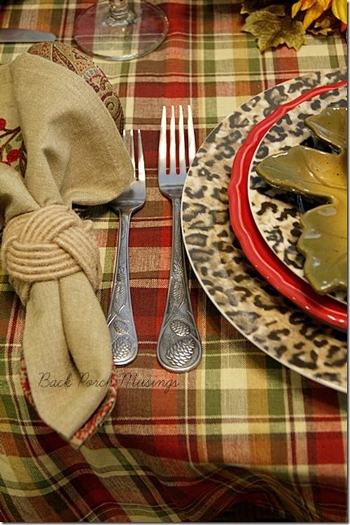 Like the combination of animal print, plaid tablecloth, napkins in neutral and red and green
