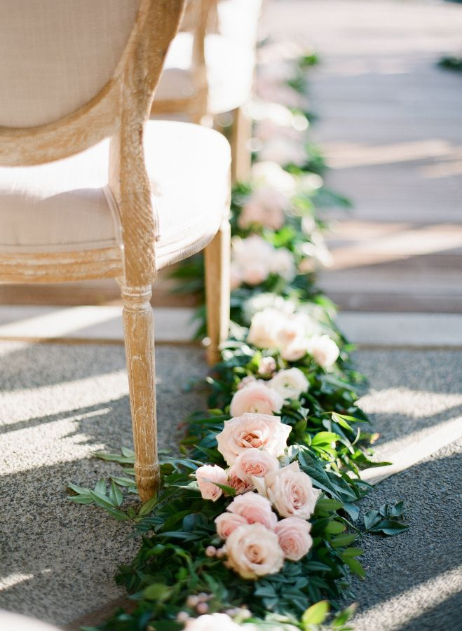 Pretty floral lined ceremony aisle: http://www.stylemepretty.com/california-weddings/rutherford/2016/06/10/spring-wedding-at-auberge-du-soleil/ | Photography: Kevin Chin - http://kevinchin.com/