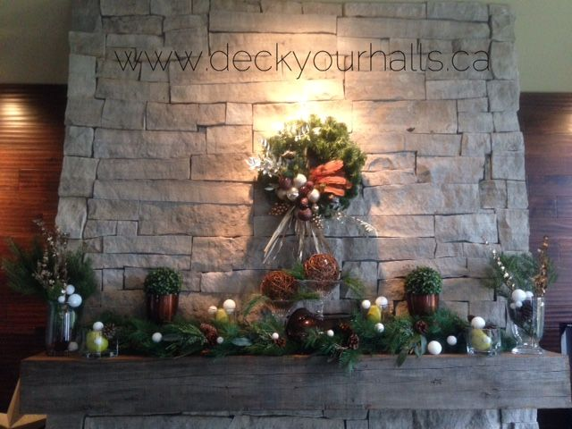 Fireplace mantel....done!  Going to use more natural greenery this year.  Love the grapevine orbs and pear green!  #christmas