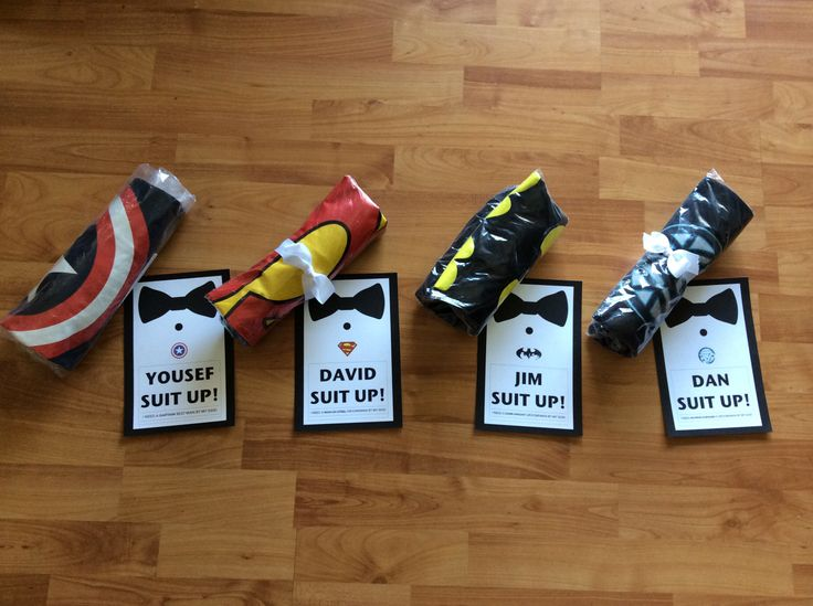 Rob's groomsmen invitations to his friends. He combined How I Met Your Mother and super heroes into one.