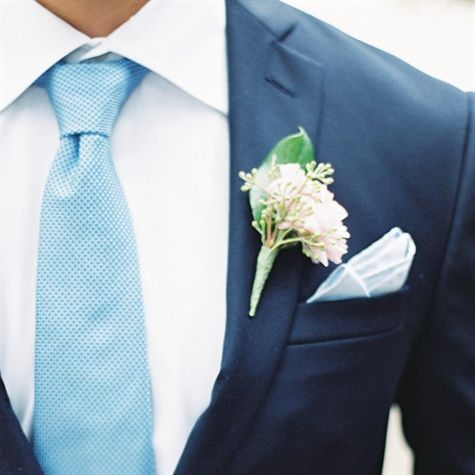 Like the dusty acqua tie, white shirt & navy suit.