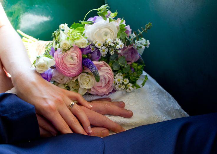 Bride and groom, wedding flowers, wedding rings.