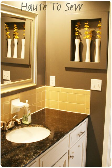 bathroom makeover yellow gray color scheme cabinets dark granite