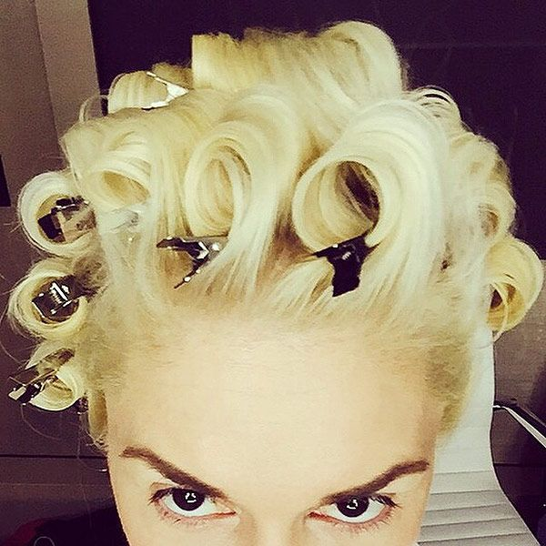 The 8 Beauty Lessons We've Learned from Gwen Stefani | 5. EXPERIMENT WITH A NEW HAIRSTYLE EVERY WEEK | Whether it's for a TV appearance, red carpet event or concert performance, The Voice coach and her 'do are always in full-fledged glam mode. Here, the singer shares a behind-the-scenes snap, pre-voluminous curls. Past styles include sleek straight hair, braids and pompadour, among others.