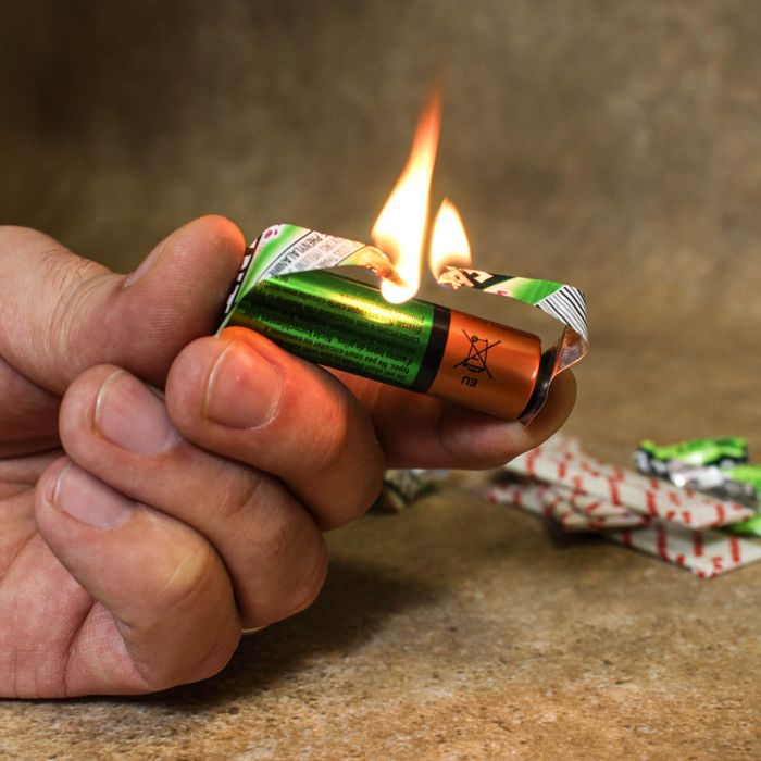 Chewing Gum and a battery can be used Fire Starter - Use the foil-backed wrapper to short circuit an AA battery and create a flame. First, tear the wrapper into an hourglass shape and touch the foil to the positive and negative battery terminals. The electrical current will briefly cause the paper wrapper to ignite. Use the flame to light a candle or tinder. WHOA! Gotta try this.