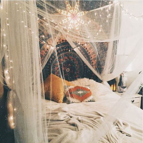 Tapestry headboard with sheer white curtains bed canopy.  urbanoutfitters:  Via uoarizona.