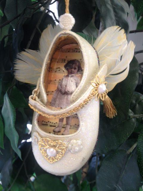 Vintage infant's shoe decorated for ornament
