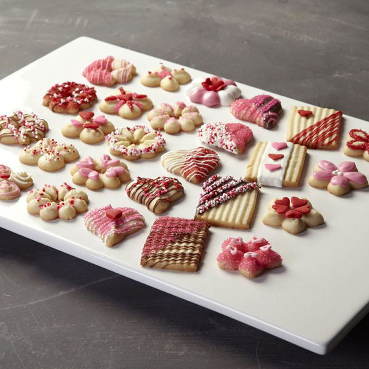 It's easy to show your love this Valentine's Day! Make a bunch of Spritz cookies using the Wilton Cookie Pro Ultra II Cookie Press and decorate them with sprinkles and Candy Melts candy.