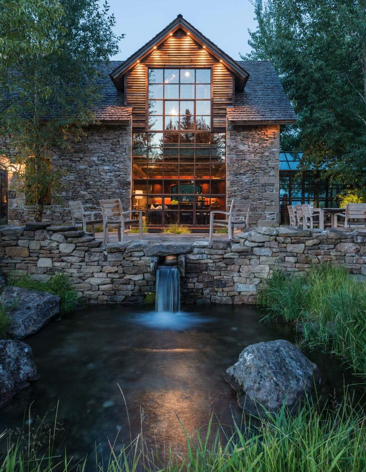 This stunning rustic stone and timber home was designed by JLF Architects along with B-D Signature, located in Jackson, Wyoming.
