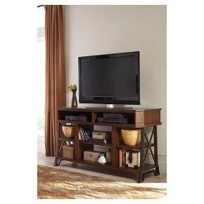 """The beautiful casual design of the """"Vinasville"""" TV stand features the rustic shape of the dark bronze color finished tubular metal legs supporting the warm brown finish bathing the shelves and top to create an inviting look that is sure to add style and function to any living area. Signature Design by Ashley is a registered trademark of Ashley Furniture Industries, Inc."""