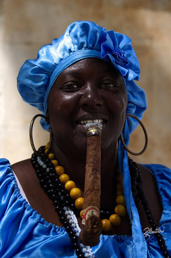 Ay Mami, que cigarro!  Follow my INSTAGRAM! Thanks! I've found this wonderful lady with a peculiar cuban cigar totally dressed in blue in the streets of the Havana. Impossible to resist to those eyes and to that smile!  For more photos follow me on instagram @riccardo_mantero