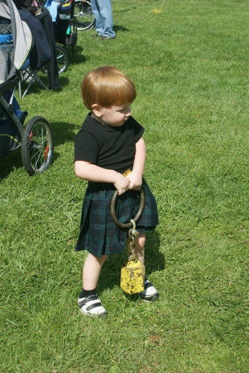 Wee bairn trying his hand at the Highland Games