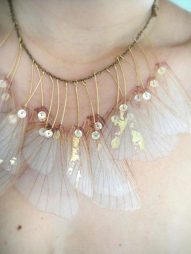 I create the pieces from this collection by transferring real butterfly/wing images onto silk and organza fabrics, then cutting and layering them to turn them into unique and unusual pieces of jewelry.