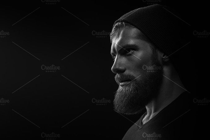 Bearded man portrait on black by Usmanov Stock Photography on @creativemarket