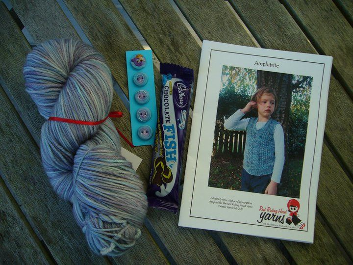 "Winter Yarn Club 2011 - June (Mermaids and Mermen) Girls Package includes: ""Nymph"" Yarn, Buttons by Benji, Chocolate fish and ""Amphitrite"" vest pattern by Amber Bertram 