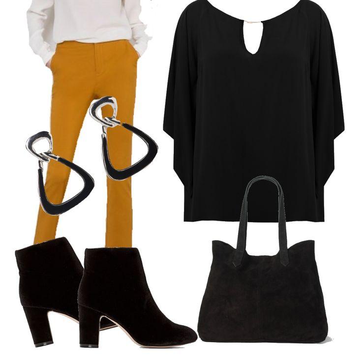 In questo total look nero- blusa comoda, stivaletti di camoscio e borsa abbinata- ho aggiunto solo una nota di colore: questi bellissimi pantaloni a sigaretta ocra.