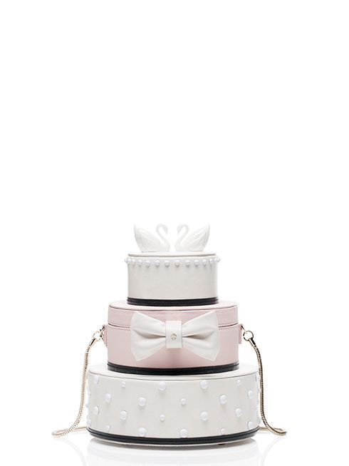 for the kind of girl who's not afraid to commit (to her true love, of course, but also to a theme) this bag--which looks almost exactly like a three-tiered wedding cake--is the perfect purse to carry to the shower, the rehearsal dinner and the reception!