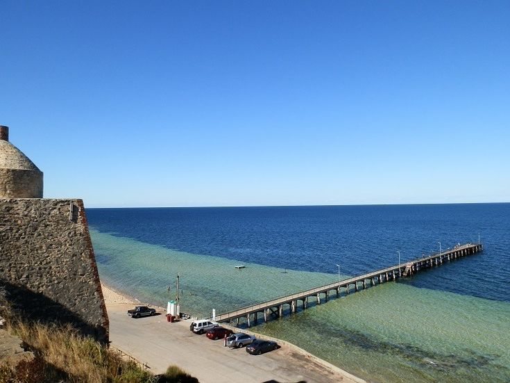 Wool Bay Jetty (and public loos) from old Limestone Kiln, Yorke Peninsula, South Australia Looking down over the steep limestone cliff into the multicoloured waters of the Southern Yorke Peninsula's Wool Bay can be a parallel universe moment as the flat and unremarkable pastoral country – often dry and arid – gives way to the vividly coloured and splendid panorama