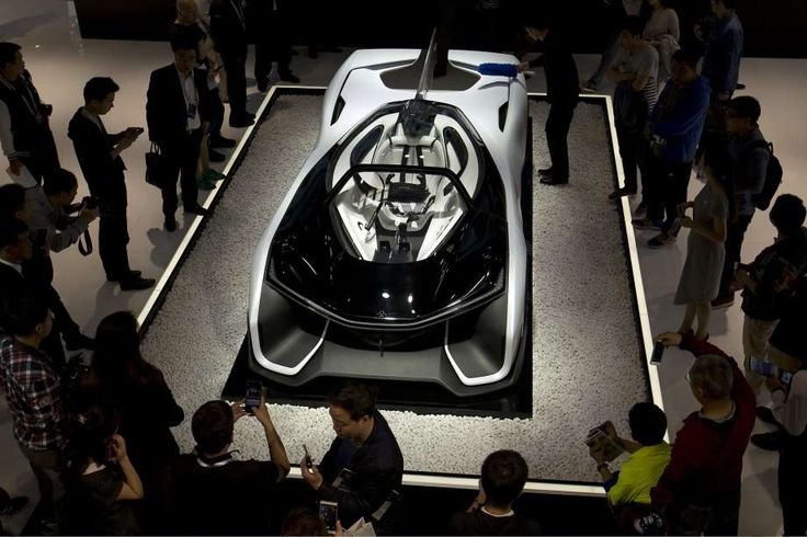 Visitors look at the Faraday Future FFZERO1 concept car on display at the Beijing International Automotive Exhibition in Beijing, Electric-car startup Faraday Future (FF) is taking steps to get its vehicle technology on the road.