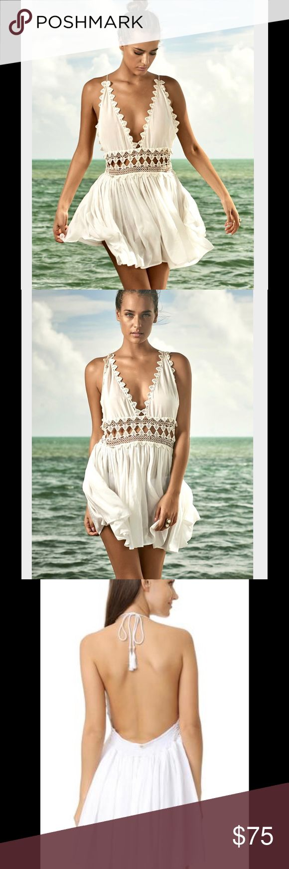 PilYQ Waterlily Crochet Dress Size XS/S Beautiful PilyQ Waterlily Crochet dress in white. So pretty and sexy. 😜  It is lines under the skirt portion of the dress. My dress is firm, I did pay full price. 🙂 Pilyq Swim Coverups