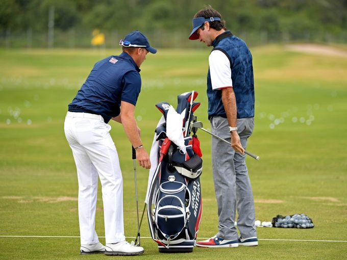 Danny Willett of Great Britain, left, talks with Bubba