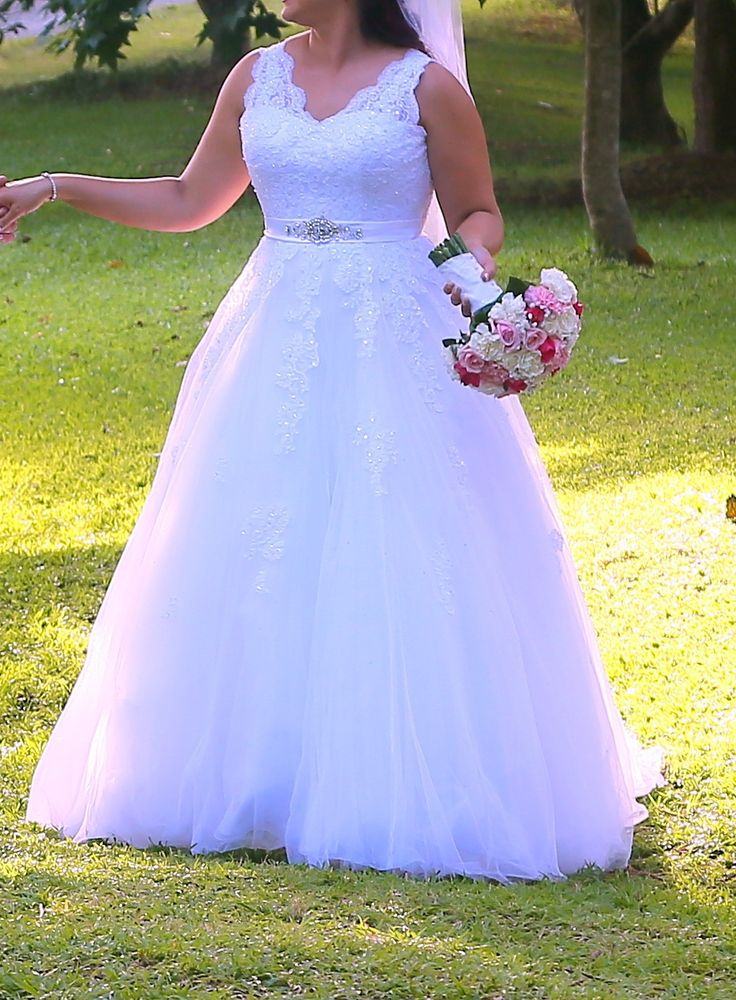 Sleeveless wedding dresses like this one are flattering on plus size brides too….
