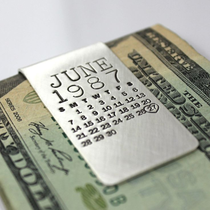 """Mark Your Calendar Hand Stamped and Personalized Money Clip - Sterling Silver. The original hand stamped calendar money clip...what a great way to commemorate a special day! Perfect for a wedding, anniversary, birthday, graduation, sobriety date...any day you want to honor and celebrate. This 1"""" wide, 20 gauge solid sterling silver, hand forged money clip will be hand stamped with ANY month from ANY year (past, present or future), and then one day will be highlighted with an oval or a…"""