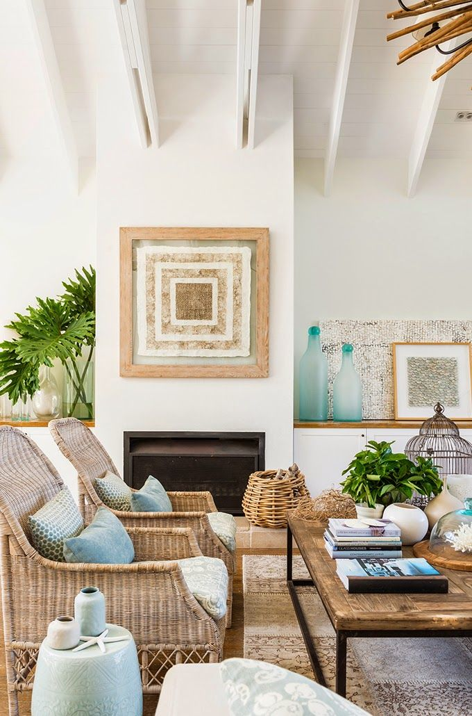 Beautiful wicker chairs in this beach house House of Turquoise: Cove Interiors
