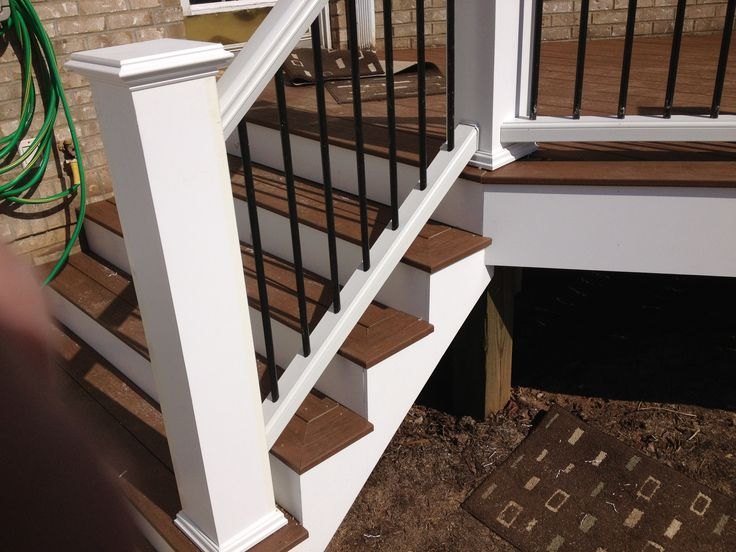 Picture framed Stairs with Trex Railings and oversized newel posts