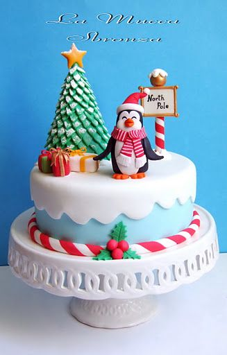Christmas cake with a tree & a penguin.