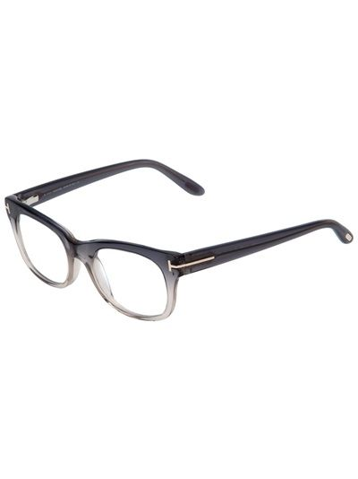 Grey glasses from Tom Ford featuring a round frame design, a graduating effect to the front, a signature silver-tone metallic design detail at the hinge and a small silver-tone design plaque at the end of the arm. The glasses also come with a brown leather case.