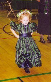 MacKenzie tartan in silk for the wedding party - flower girl.