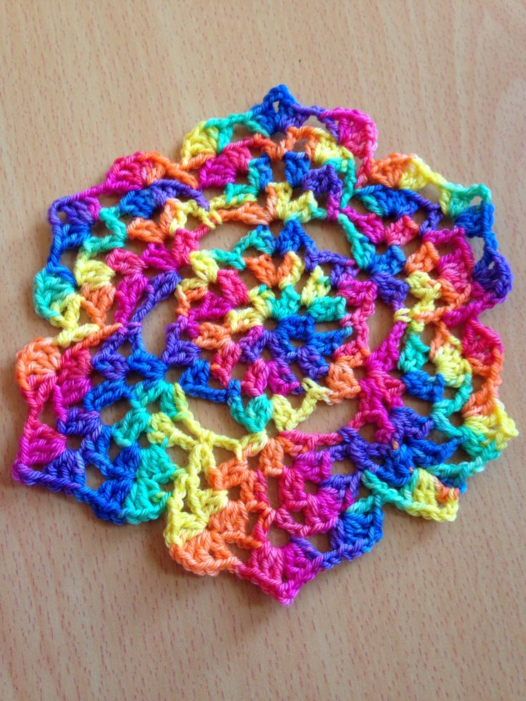 Hand dyed sock yarn doily crocheted from a chart rather than a written pattern