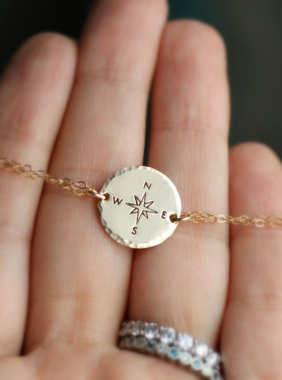 14k gold fill Compass Bracelet.   ✧ Not all who wander are lost ✧  Whether graduating and moving on or traveling to a far away land, give this bracelet as a reminder that life is a beautiful journey.  ◇ All metal is 14k gold filled ◇ Hand stamped compass symbol ◇ Hand hammered edge finish ◇ Lobster clasp, completed with two tiny crystal pearls.  :::: Pendant measures 5/8 inch in diameter (see photo in hand of size reference) :::: :::: Bracelet length is 7 inches (made to fit a 6 wrist)…