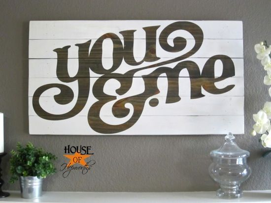 You & Me Wood Board: This wooden barn-door style board was transformed into a custom piece of artwork with vinyl, Mod Podge, stain, and paint.