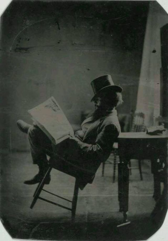 Portrait of a gentleman reading the newspaper, c.1880