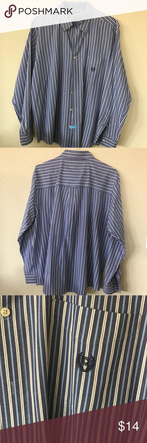 Chaps long sleeve button down shirt Chaps long sleeve button down shirt in blue with shades of blue and yellow stripes. Chaps logo on front pocket in blue. Buttons at the collar to hold tie in. Chaps Shirts