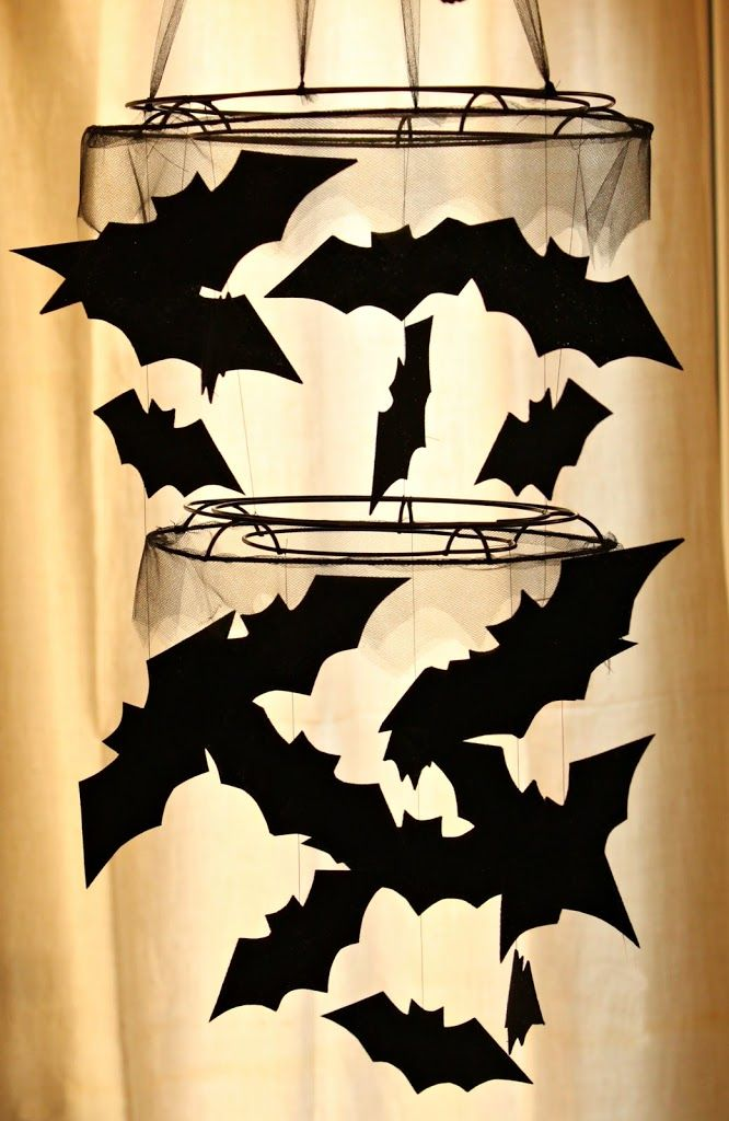 diy halloween bat chandelier tutorial might not be good for over babys crib but fun and spooky hanging bats is fun all october long in this pottery barn