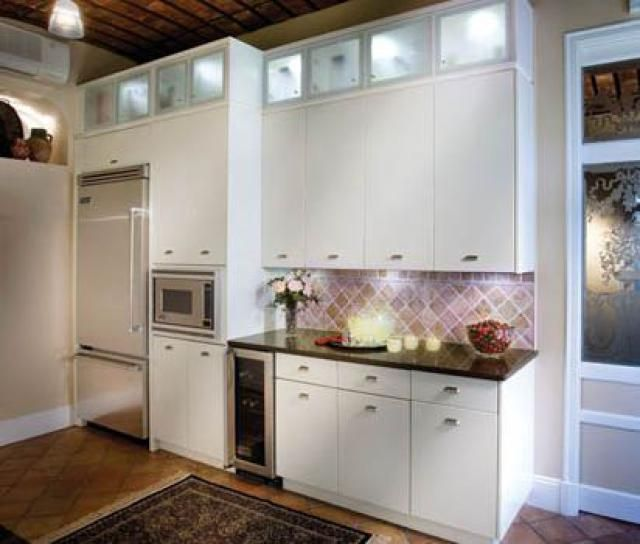 10 Contemporary Kitchen Designs You'll Want For YOUR Home: High In-Cabinet Lighting Expands This Contemporary Kitchen