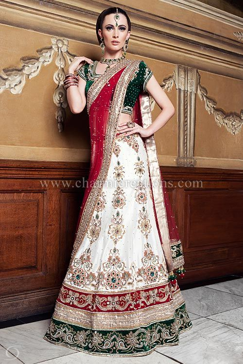 Indian Wedding Outfit - Traditional off-white raw silk wedding lengha with 3 colour velvet borders and emerald green velvet blouse