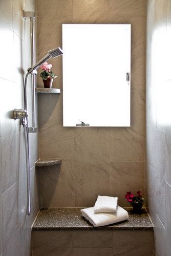tiny shower stall with seat