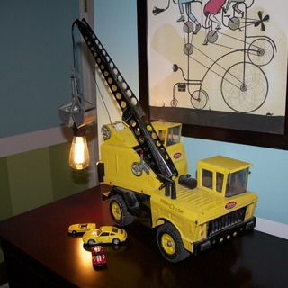 Metal!! I know they don't come with the lamps, but my brother and I had a ton of the old metal Tonka trucks, those were the best, now they are crap made outta plastic