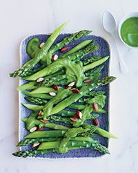 Pan-Roasted Asparagus in Asparagus Sauce Recipe on Food & Wine // This clever dish from chef David Chang makes double use of asparagus: first, it's used to make a delicate, sweet sauce, then the spears are sautéed and served in the sauce.