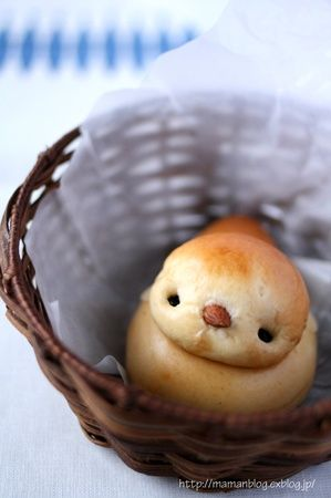 Baby chick biscuits... Form dough into a bird shape and add currants and an almond. Very cute.