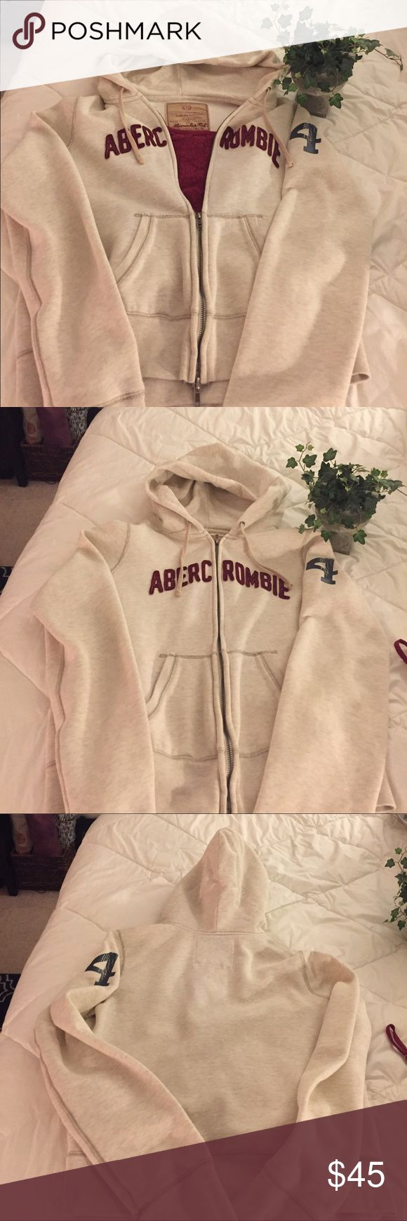 Abercrombie Hooded Zip Up Jacket Fun and comfy zip up hooded sweat jacket. Great condition, like new! No holes, stains, rips, or piling. Heavier material very soft. Fits medium or large very roomy. Cream and Burgundy in color and a blue number on left arm. Fun to wear with different tanks or shirts or by itself whatever you desire! the weather it's a great go to hoodie!! Abercrombie & Fitch Jackets & Coats