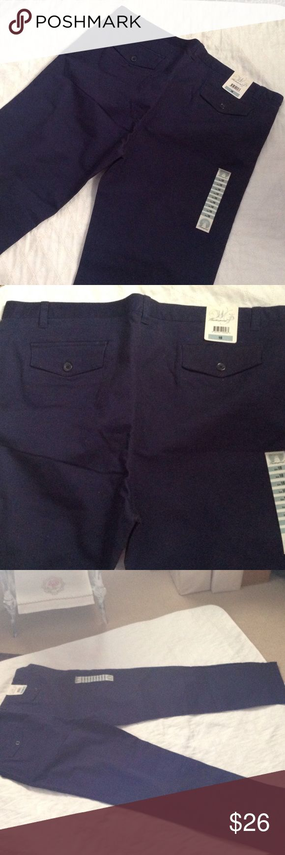 New size 18 women's navy pants by Weatherproof A new pair of Weatherproof navy blue ladies pants size 18. No stains, rips from a smoke free home. Inseam measures 30 inches. These have 2 % spandex for a more comfortable fit. Weatherproof Pants Trousers