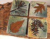 "Backsplash Accent Ceramic Tile Kitchen Bath Tile  1 3/4"" ""Change of Seasons"" glaze with tree leaves. $5.00, via Etsy."