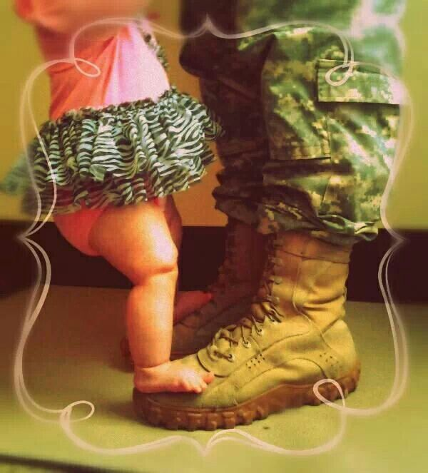 Army baby girl.  Only with Navy flight suit and boots of course. ;)