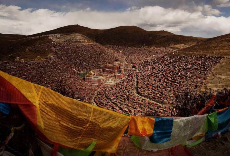 Daily Life, 2nd prize stories. Tibetan Buddhists take part in the annual Bliss Dharma Assembly. The last of four annual assemblies, the week-long annual gathering takes place in the ninth month of the Tibetan calendar and marks Buddha's descent from the heavens.<br><br>In this photograph, Tibetan prayer flags, known as Lung-ta, on a hillside in the Larung Valley of Sertar County, Garze Tibetan Autonomous Prefecture, Sichuan province, China, Oct. 30, 2015.